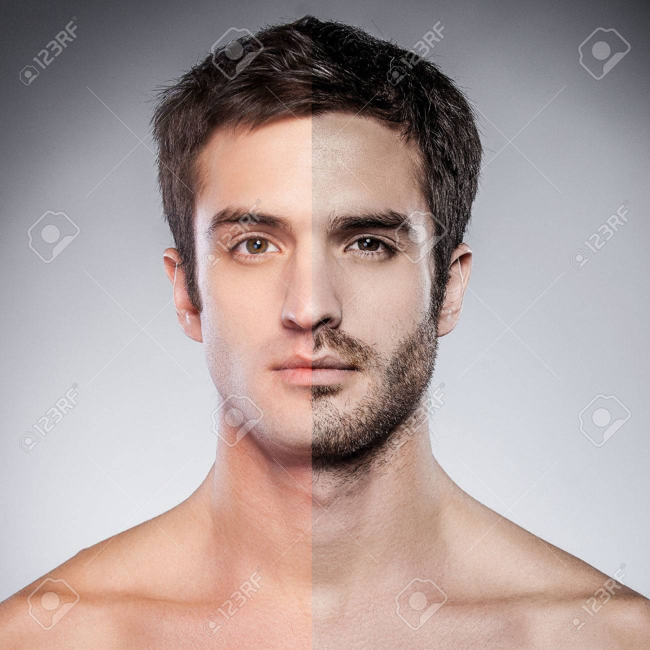 Handsome Young Man With Half Shaved Face Looking At Camera While Standing Against Grey Background Stock