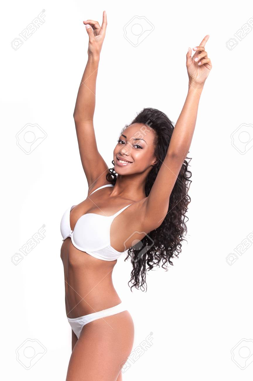 ebb7b97fc5 Healthy and beautiful. Attractive young Afro-American woman in white bra  and panties posing