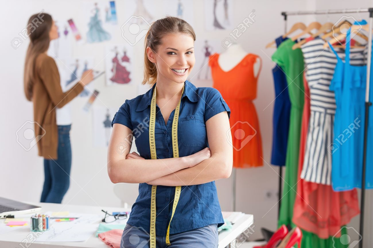 Fashion Designers At Work Beautiful Young Woman With Measuring Stock Photo Picture And Royalty Free Image Image 27923029