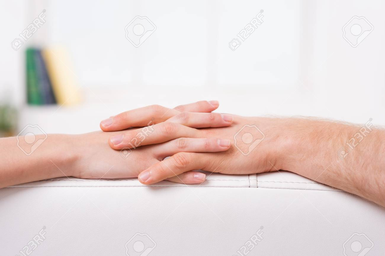 Never Let You Go Close Up Of Man And Woman Holding Hands Stock