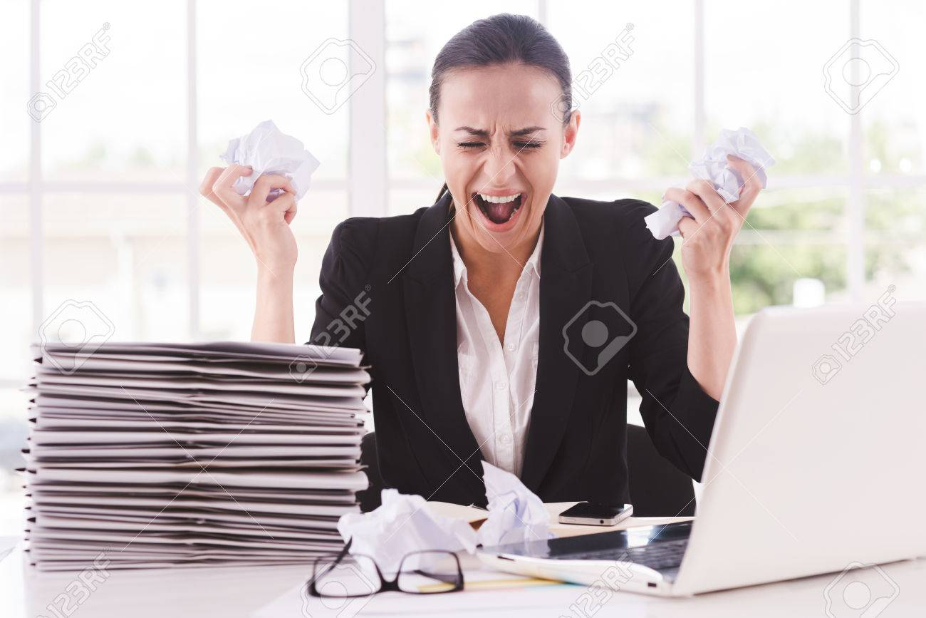 that is too much for me furious young w in formalwear holding stock photo that is too much for me furious young w in formalwear holding papers in hands and shouting while sitting at her working place
