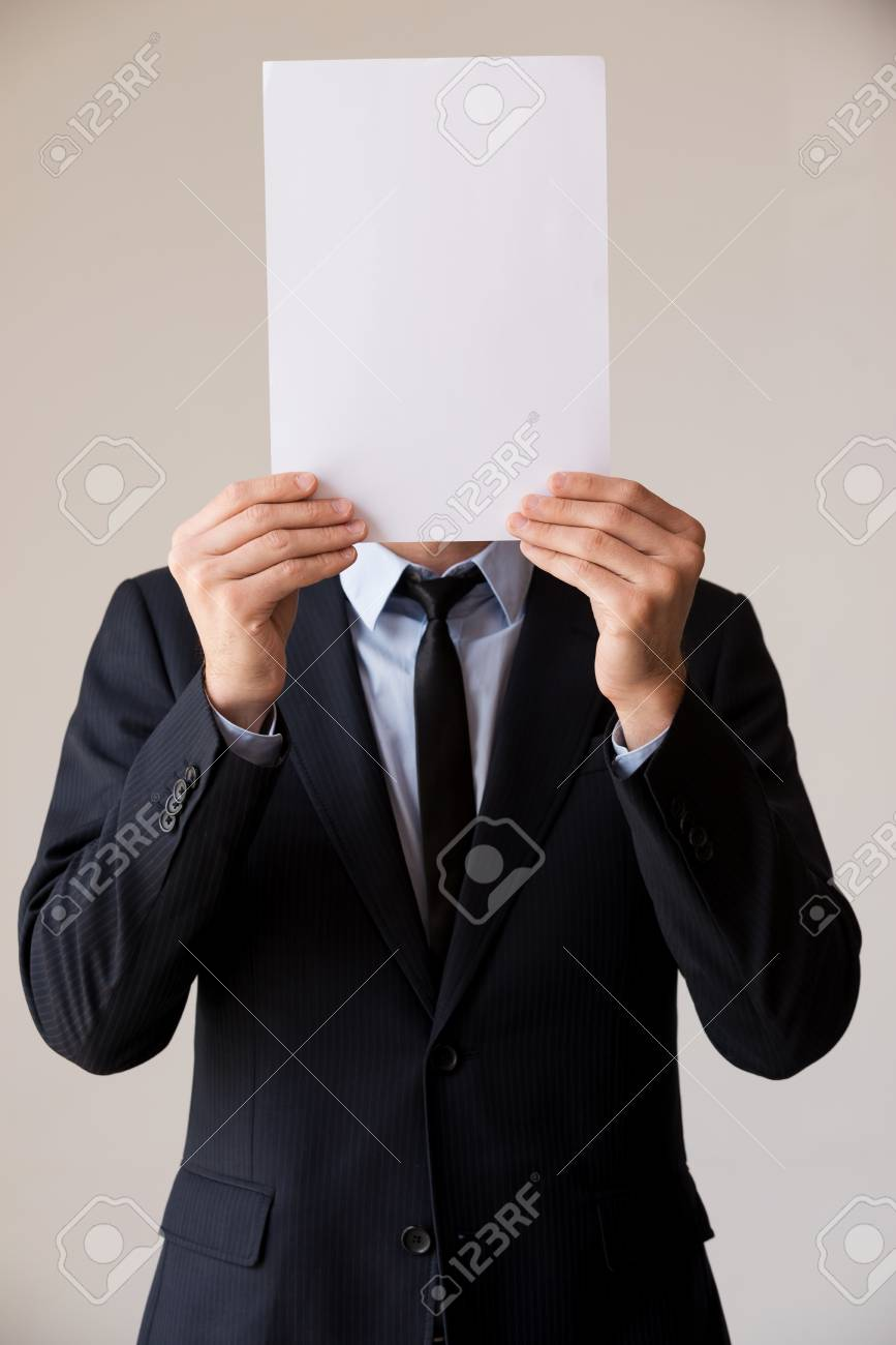 Paperwork In His Head Man In Formalwear Hiding His Face Behind