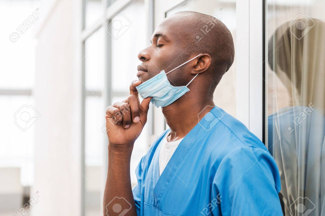 Doctor In Of African Side Off Uniform Taking Young Blue View