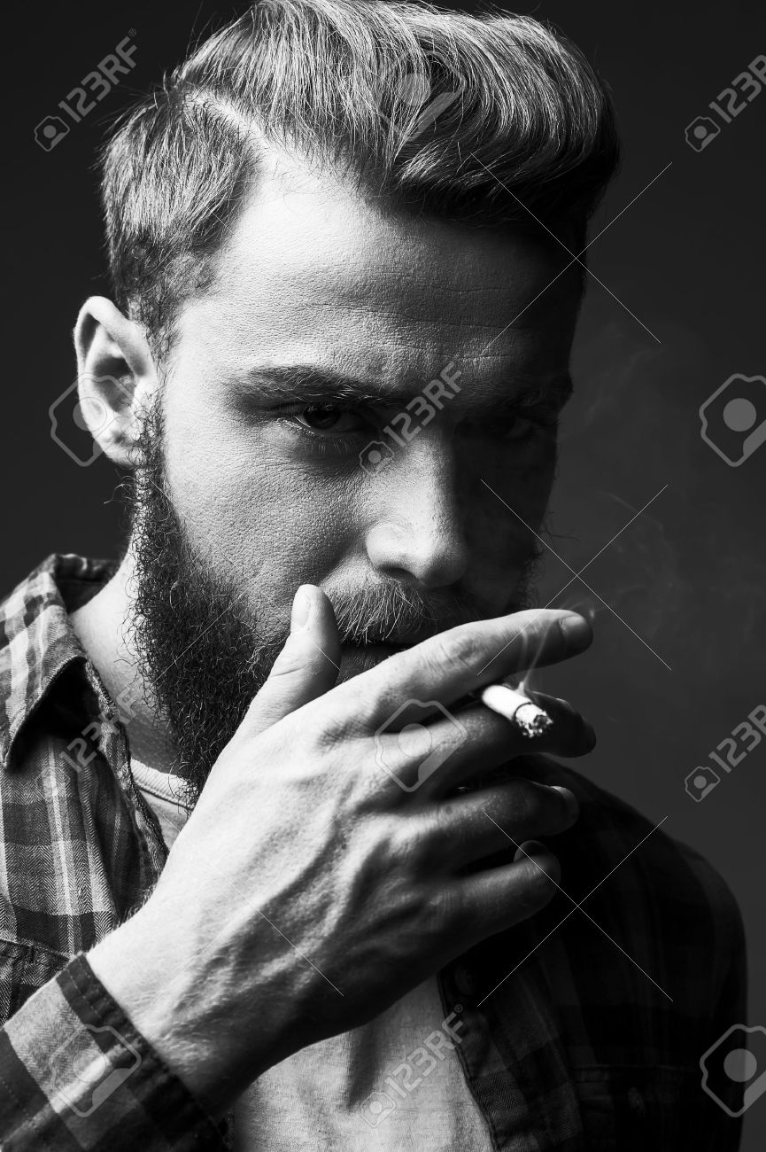 Bearded man smoking black and white portrait of handsome young