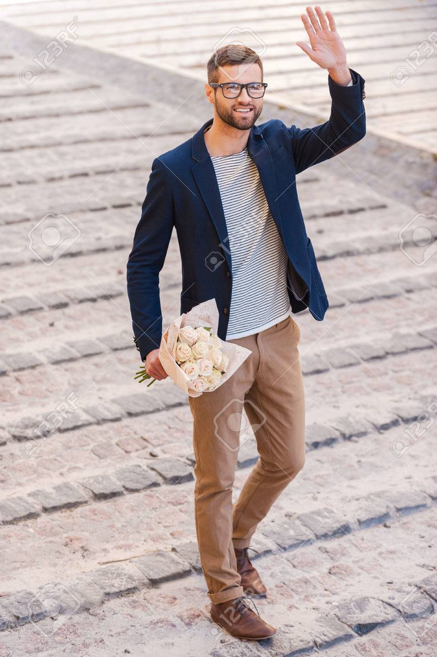 Hi there! Full length of cheerful young man in smart casual wear