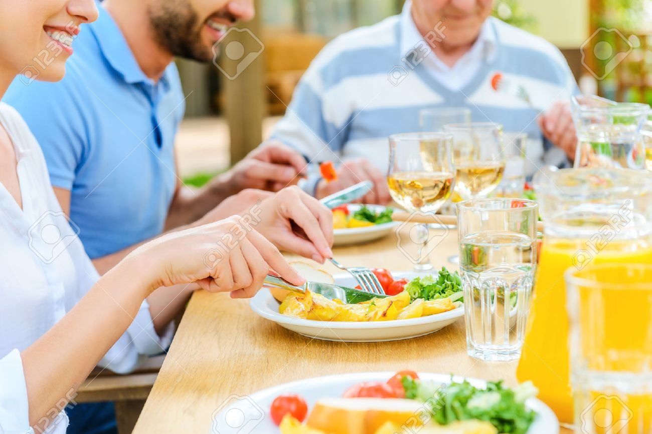 Family dinner table with food - Family Dinner Family Dinner Close Up Of Family Enjoying Meal Together While Sitting