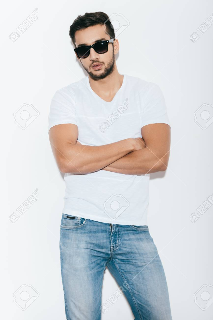 Cool And Handsome Handsome Young Indian Man In Sunglasses Keeping