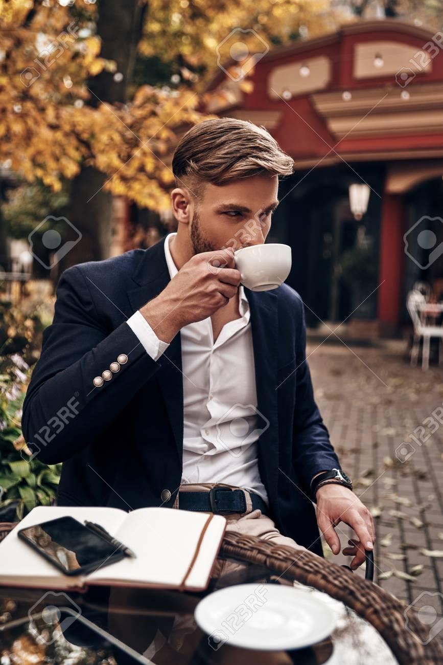 Enjoying Fresh Coffee. Handsome Young