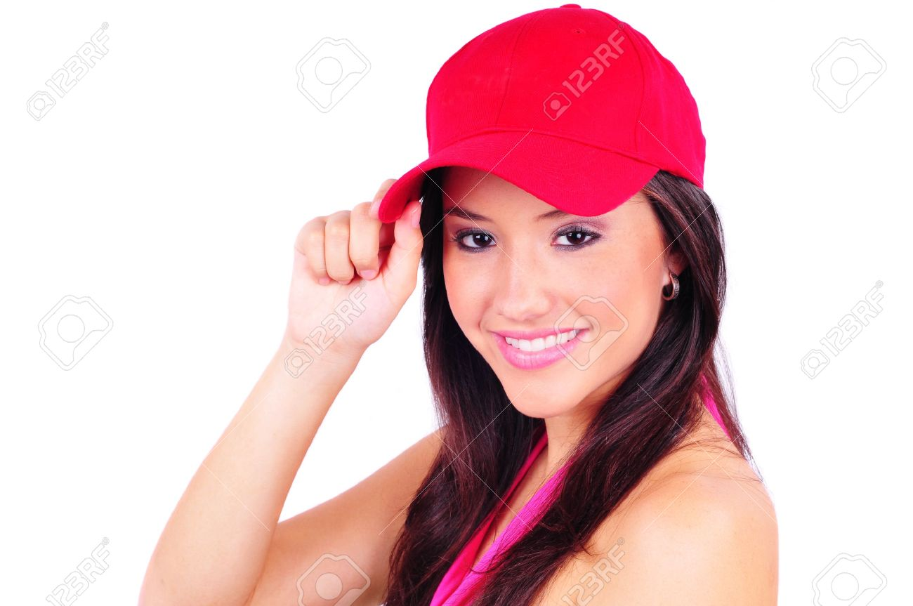 Attractive young woman wearing a red baseball cap Stock Photo - 21200782 38946d653da5