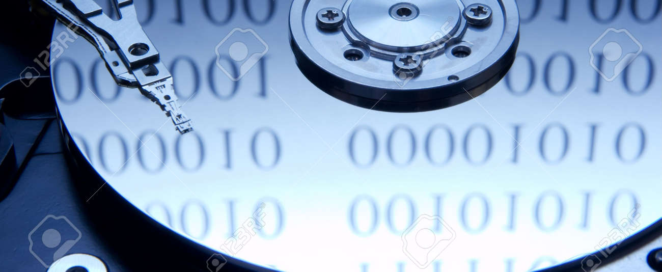 Internals of a hard drive with binary code reflection Stock Photo - 794742