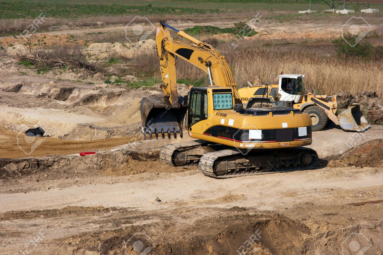 Road construction site with yellow excavator doing soilwork Stock Photo - 870913