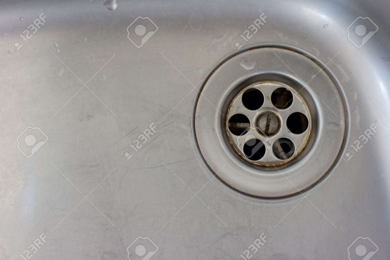Metallic background with the drain in a wash basin Stock Photo - 925716