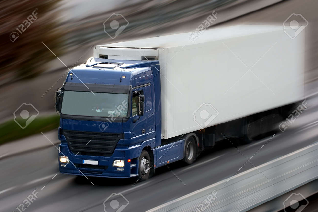 Truck going fast on the road with motion blur Stock Photo - 2330121