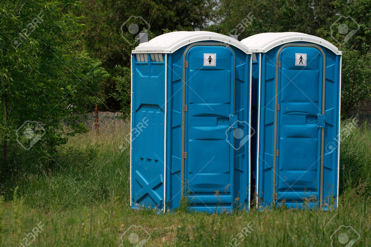Blue mobile toilet cabins in an outdoor scene Stock Photo - 3532970