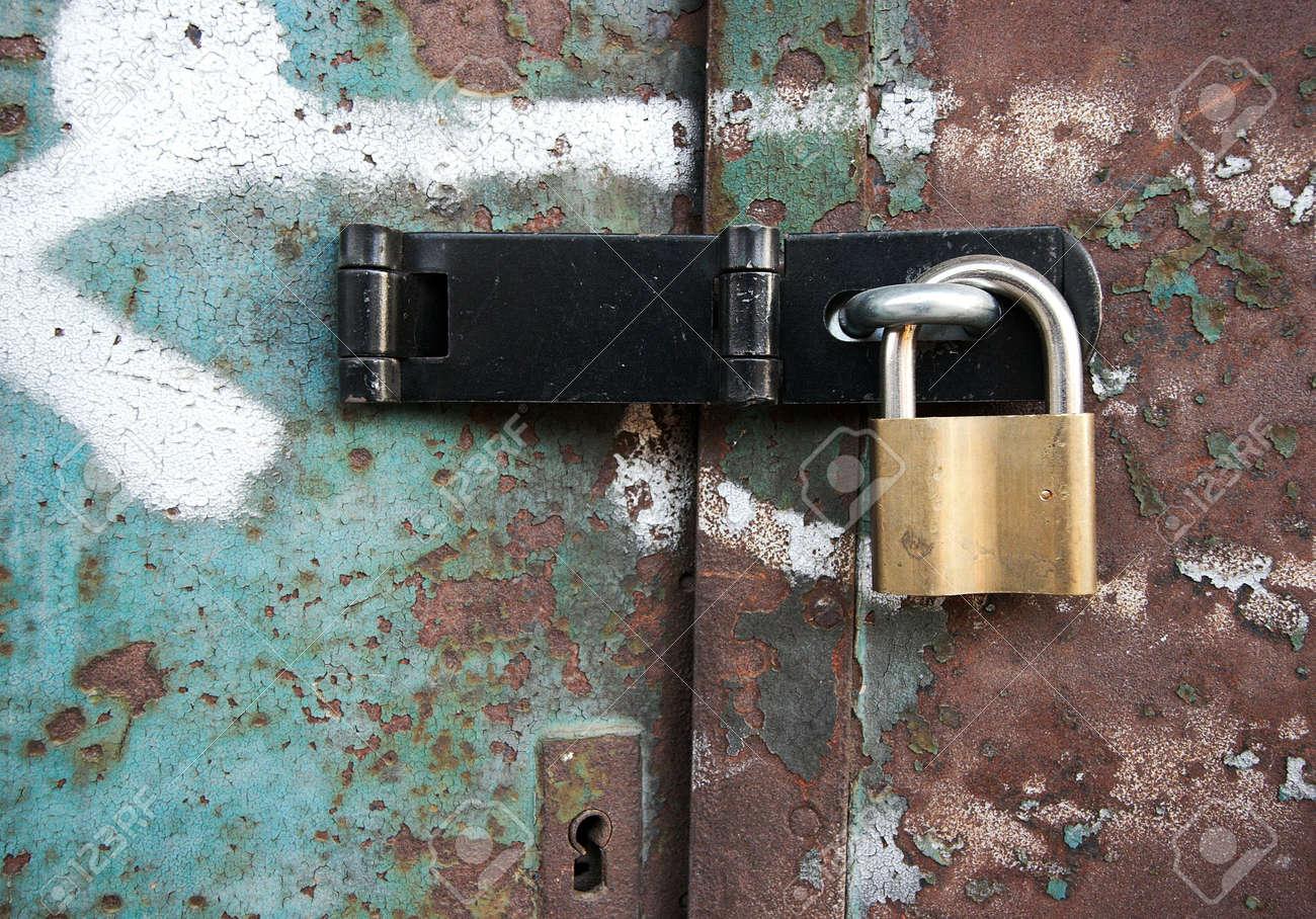 Rusty Metal Door rusty metal door locked with a padlock stock photo, picture and