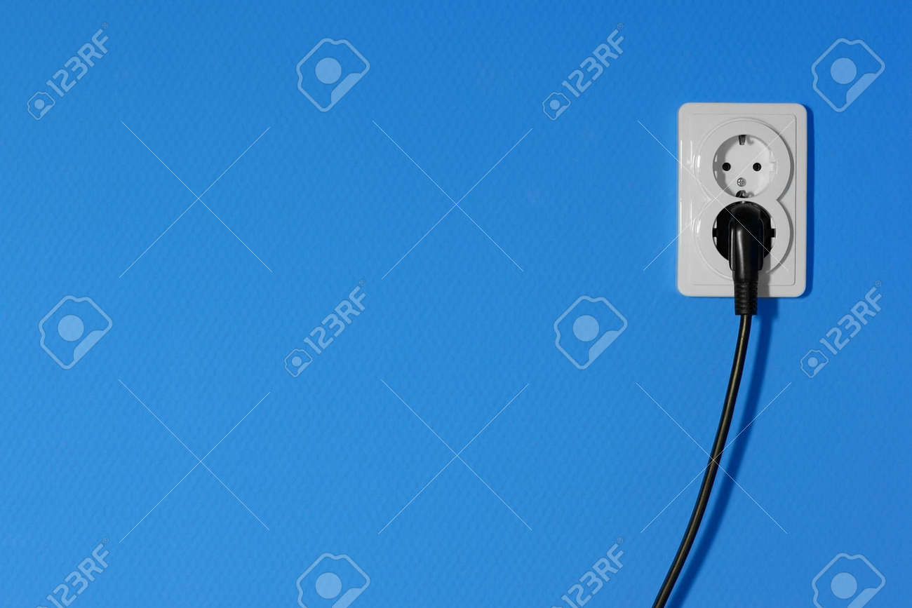 Electric outlets on a blue wall Stock Photo - 4707231