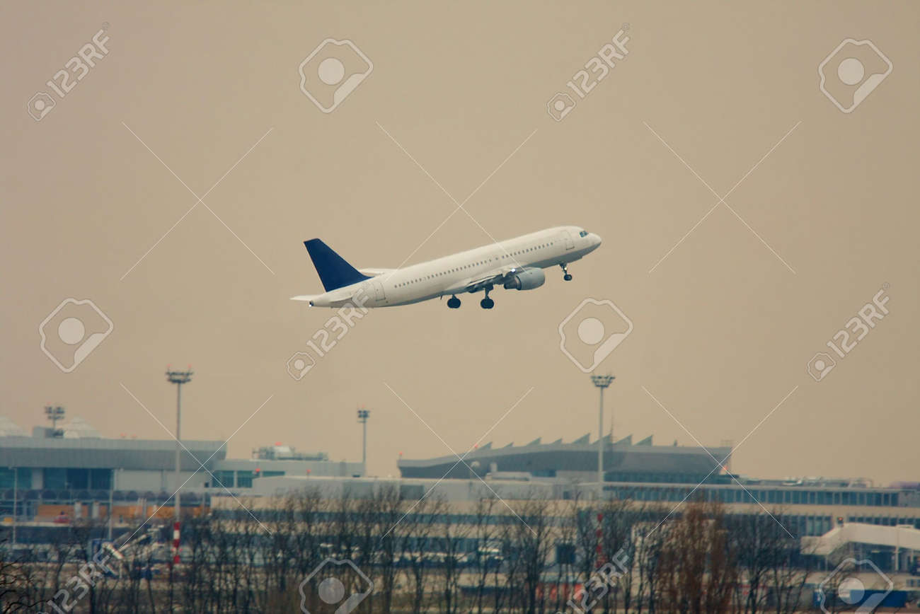 Airplane take off over an airport in twilight Stock Photo - 4875147