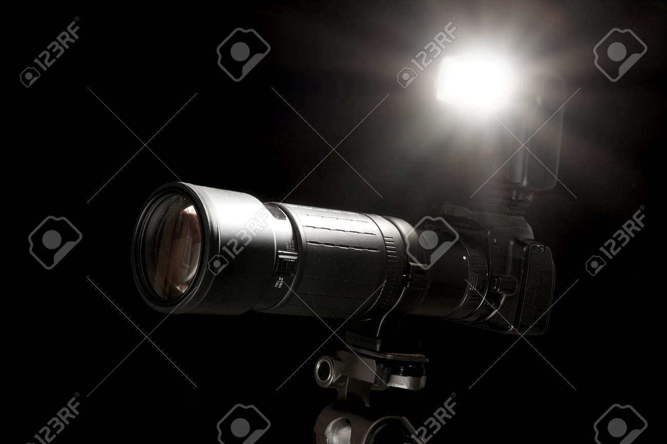 Camera With Flash Going Off Isolated On Black Background Stock Photo Picture And Royalty Free Image Image 5568027