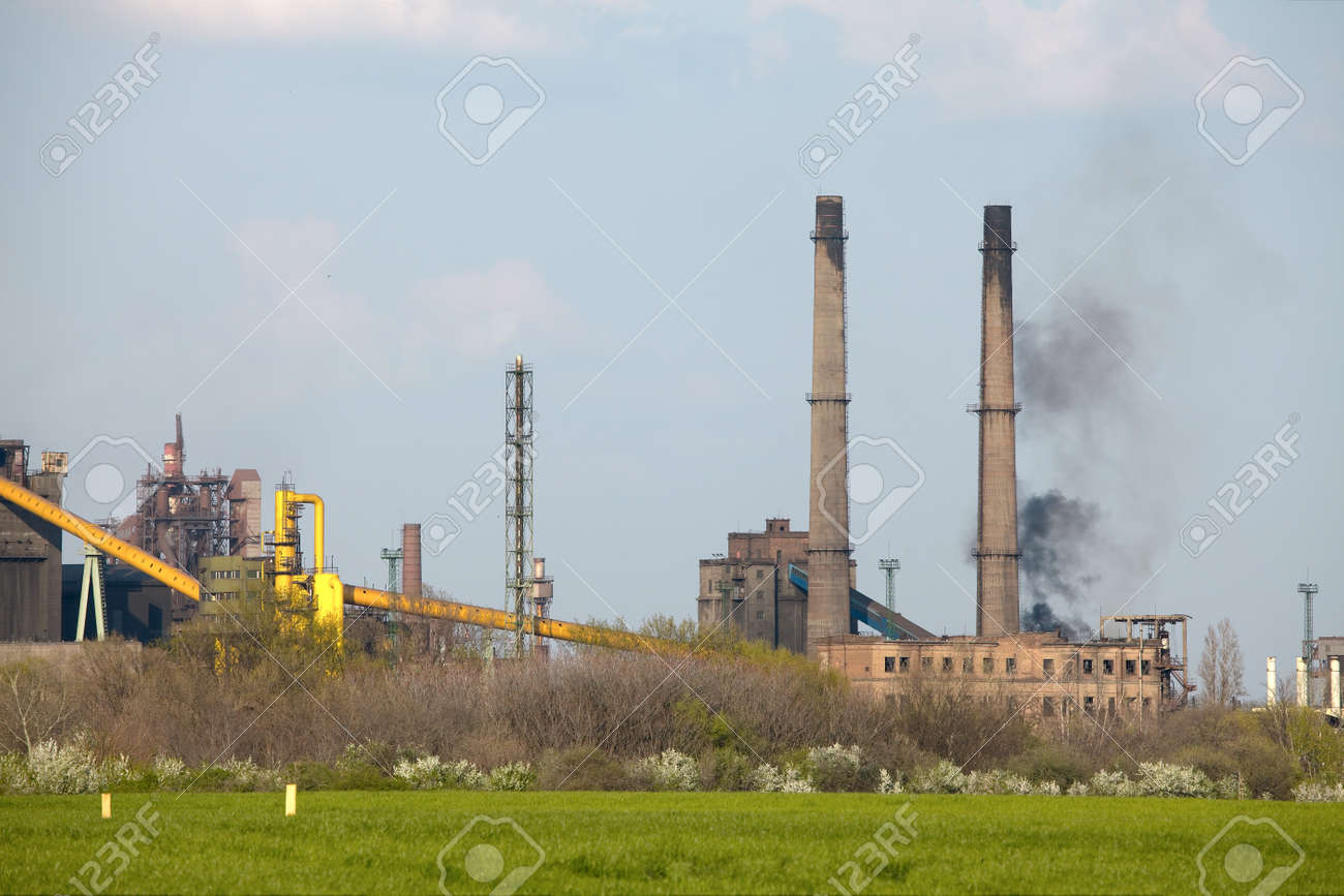 Industrial complex with smoke rising Stock Photo - 8014125