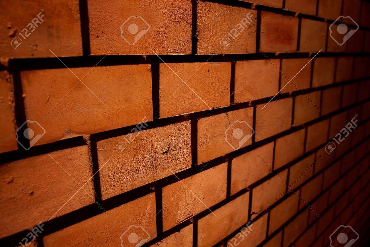 Simple brick wall at night Stock Photo - 12650931