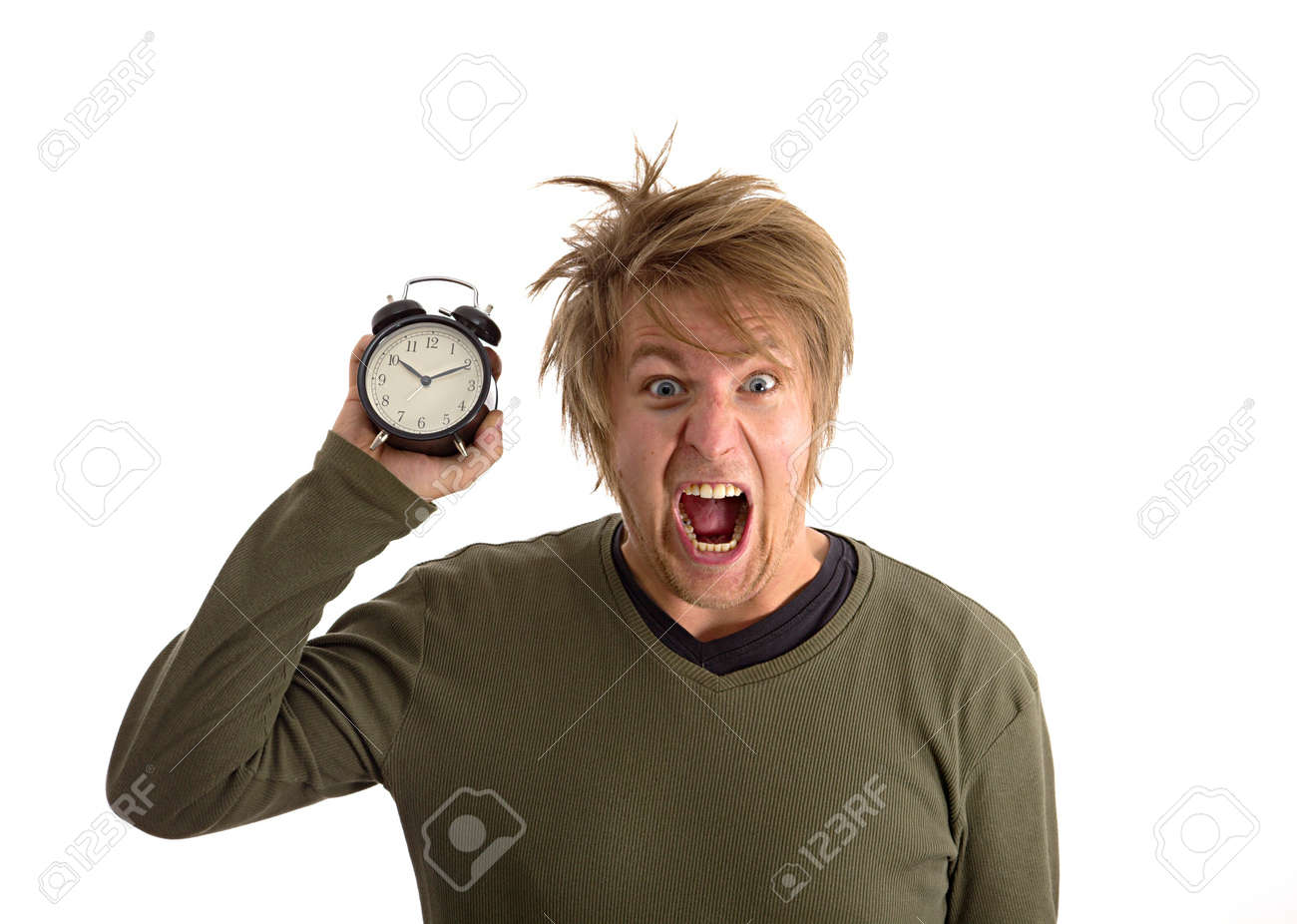 Yelling man with alarm clock in hand Stock Photo - 16640816
