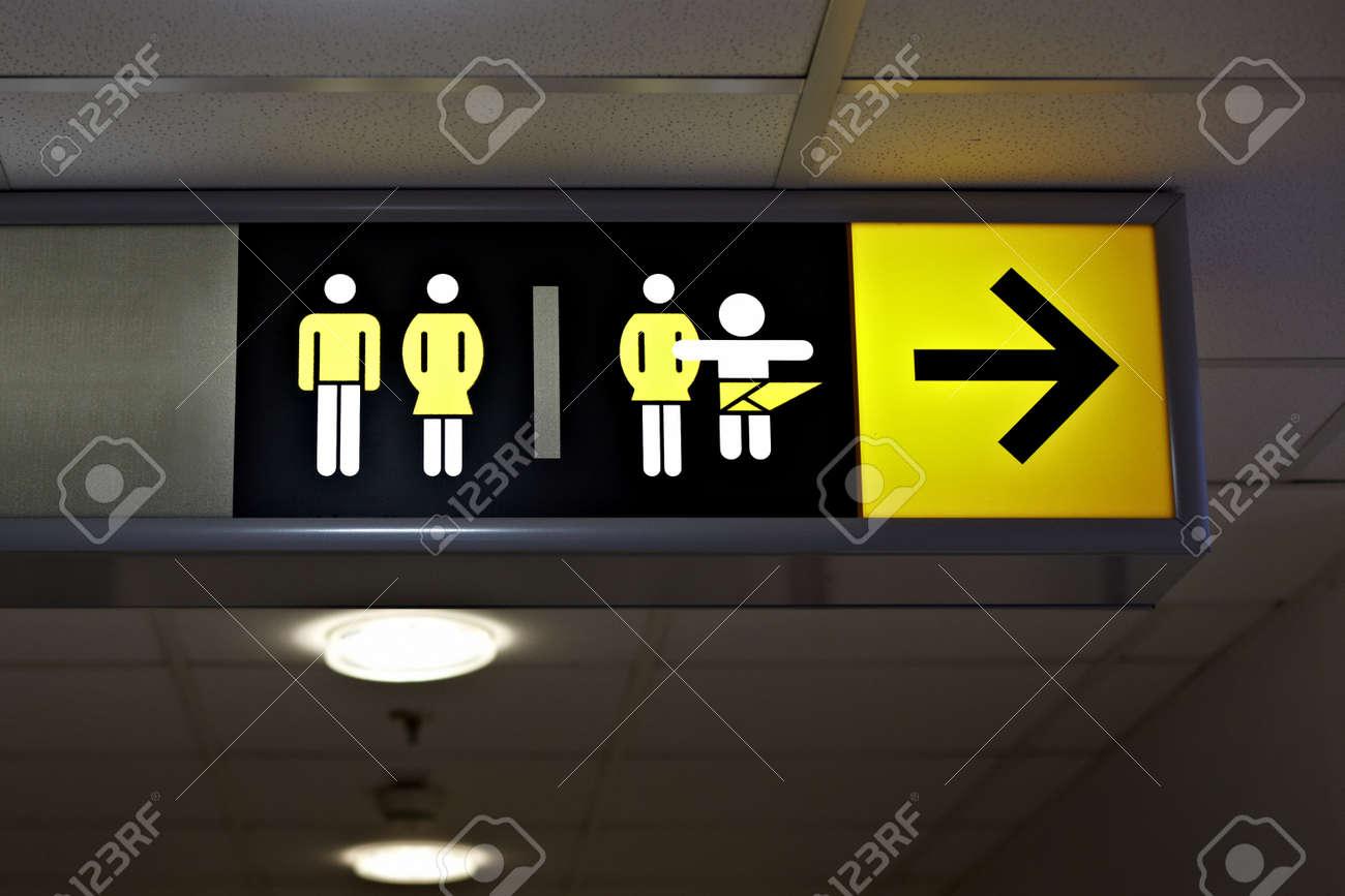 Toilet sign on a corridor Stock Photo - 19080654