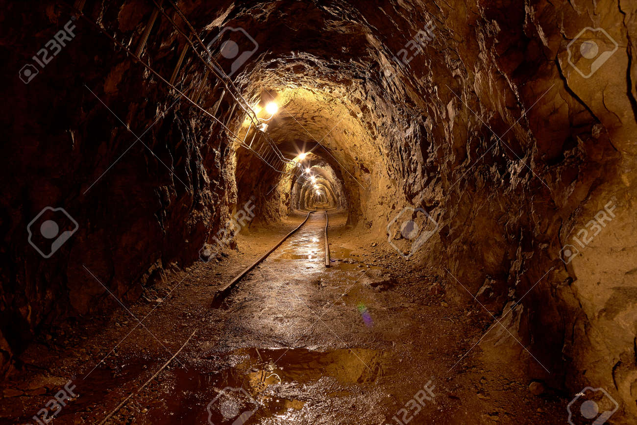 Mining tunnel with lights and rails Stock Photo - 23049555