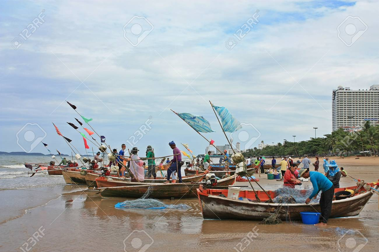 Pattaya beach,Thailand fishermen pack fishing net  Stock Photo - 15347170