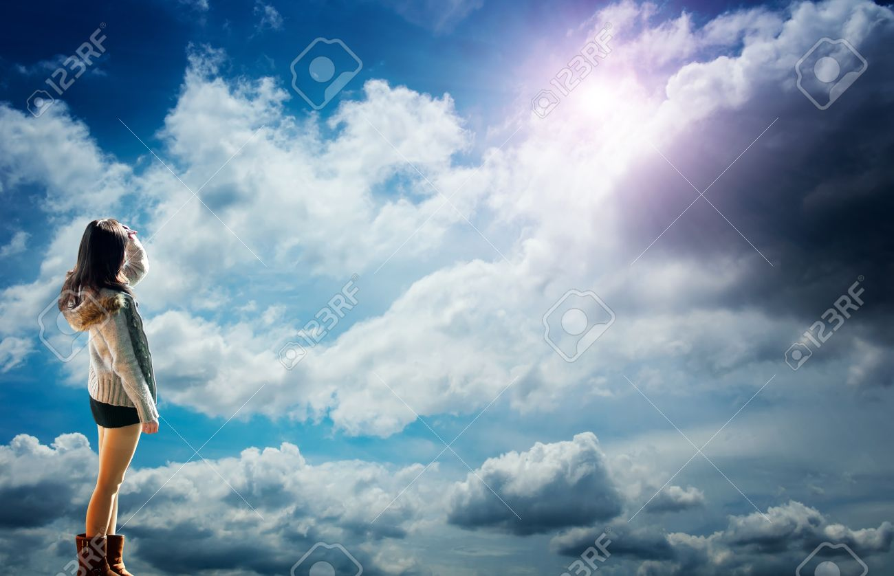 Beautiful Young Girl Looking Up At The Sky Enjoying The Warm Stock Photo Picture And Royalty Free Image Image 13313679
