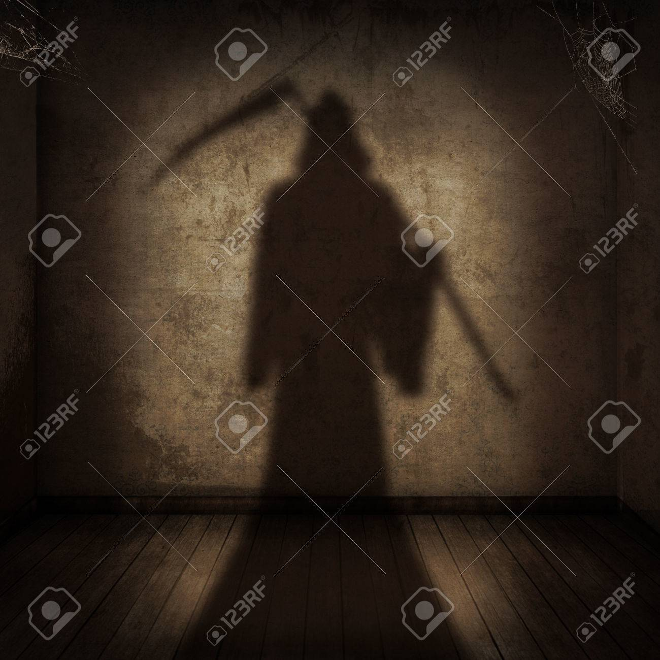 The shadow of the death with a scythe entering an empty room - 29235348