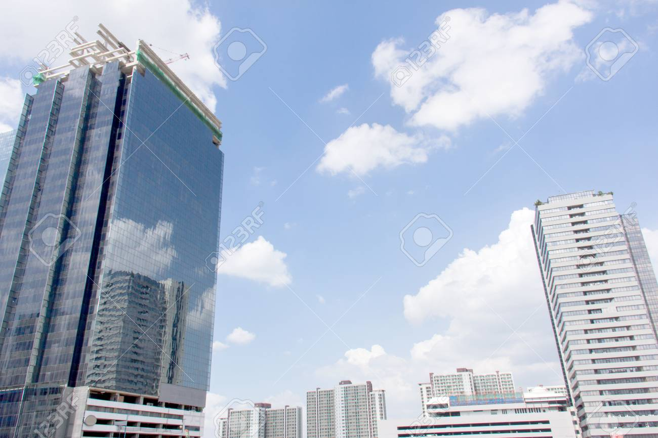 Building reflected in windows of modern office building against blue sky Stock Photo - 26814435