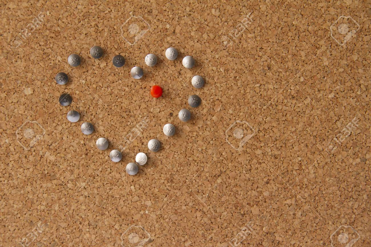 Cork office board with heart made from pins with red pin in the middle Stock Photo - 16902399