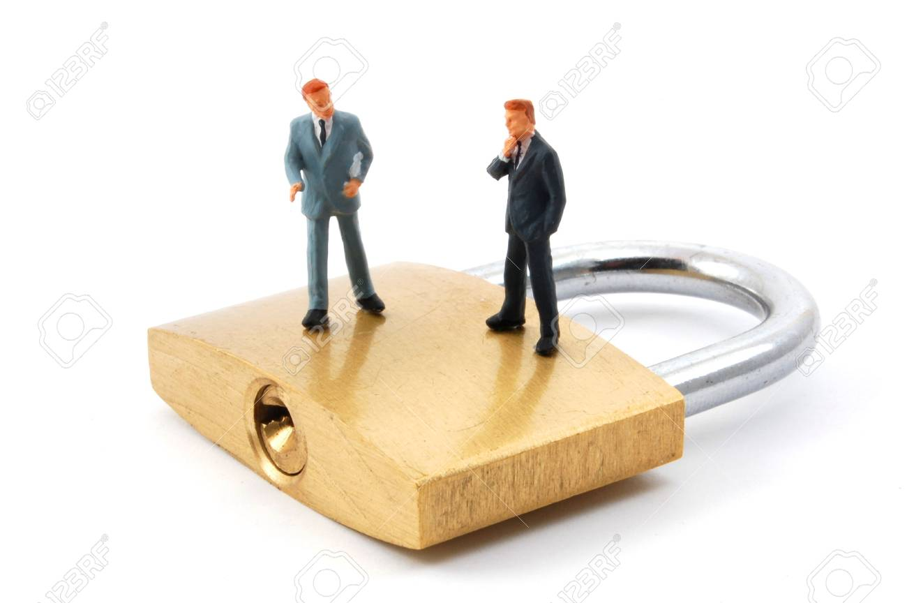 business man on secure pedlock isolated on white background Stock Photo - 4775379