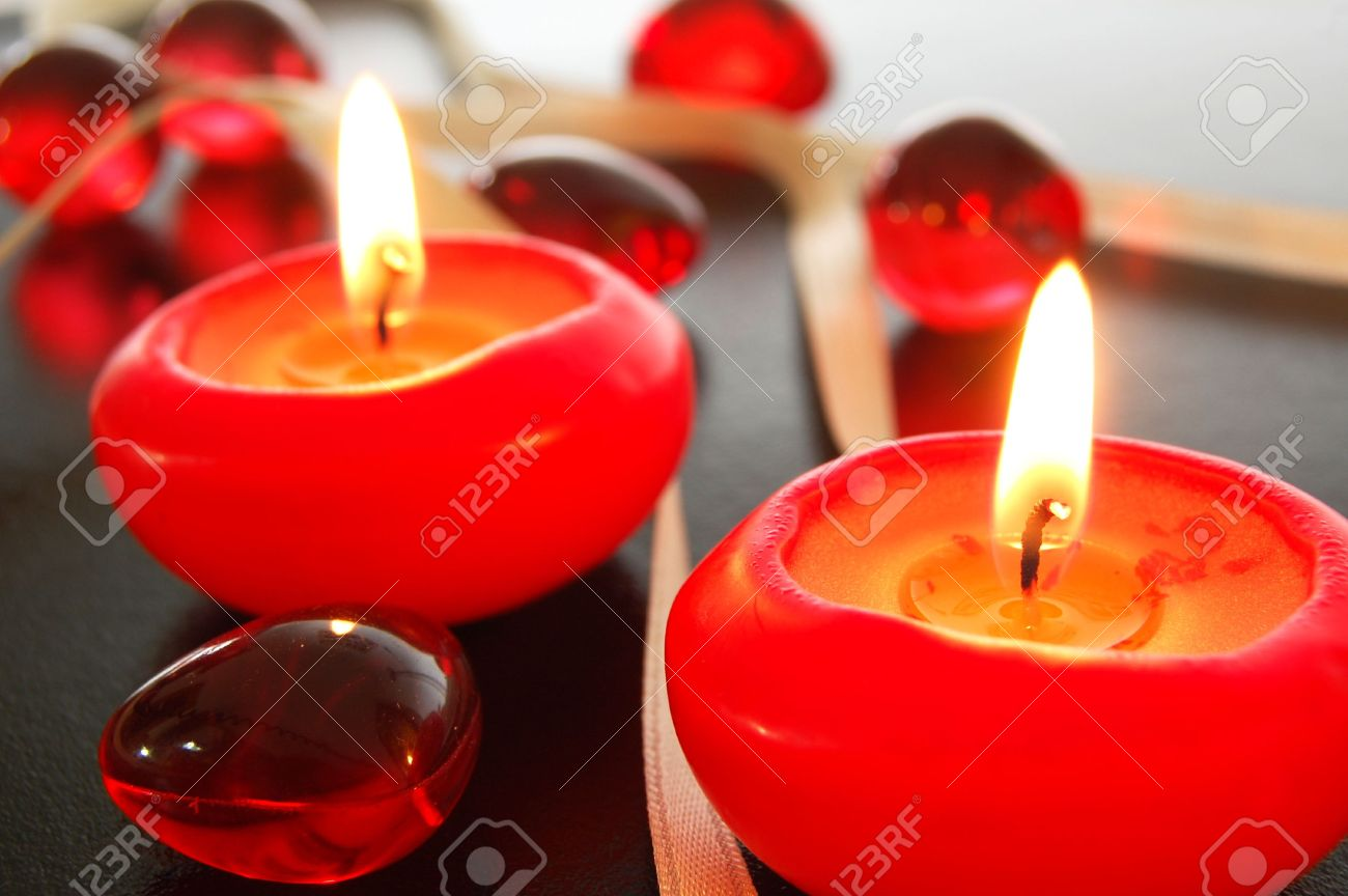 spa decoration with candles on black background stock photo