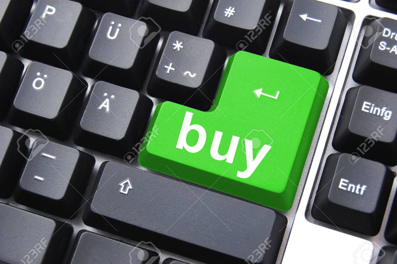 green button an keyboard showing online business concept Stock Photo - 5392191