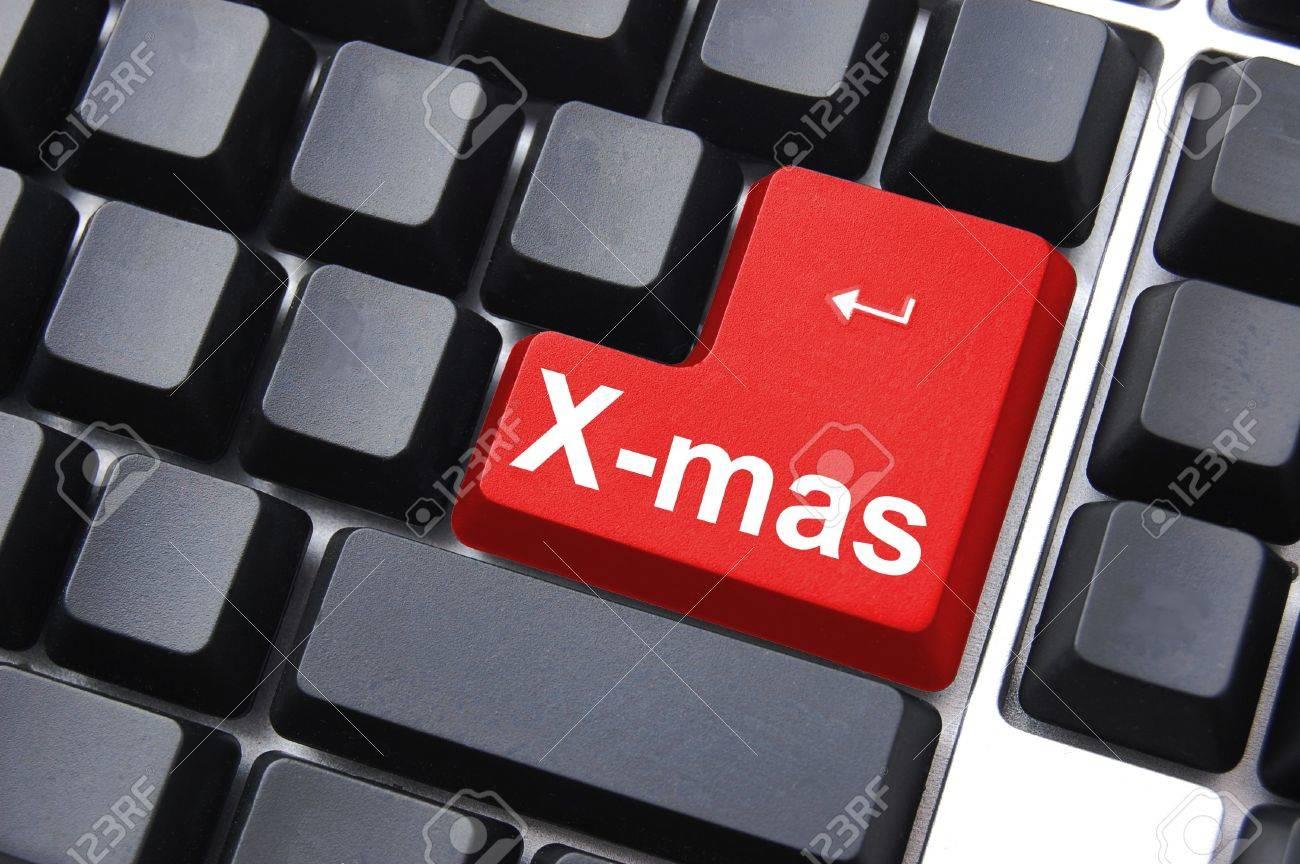 xmas christmas or x mas concept with computer button Stock Photo - 5659052