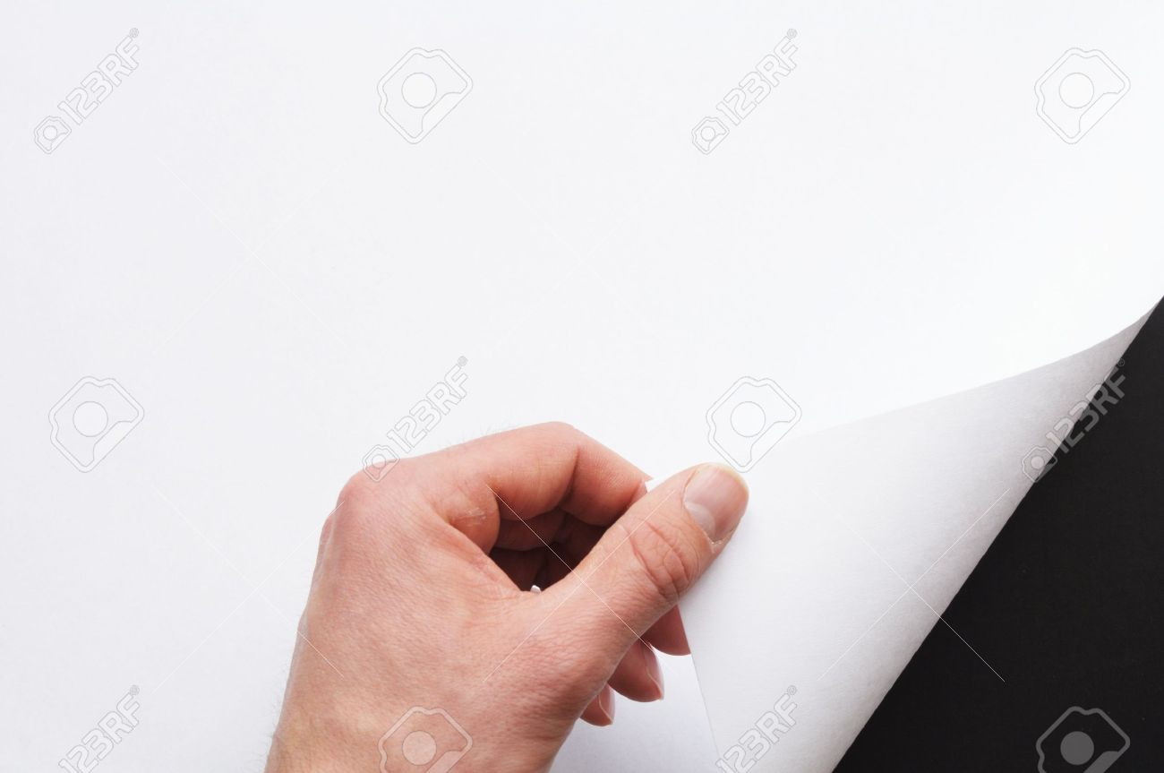 hand turning over blank sheet of paper Stock Photo - 7127301