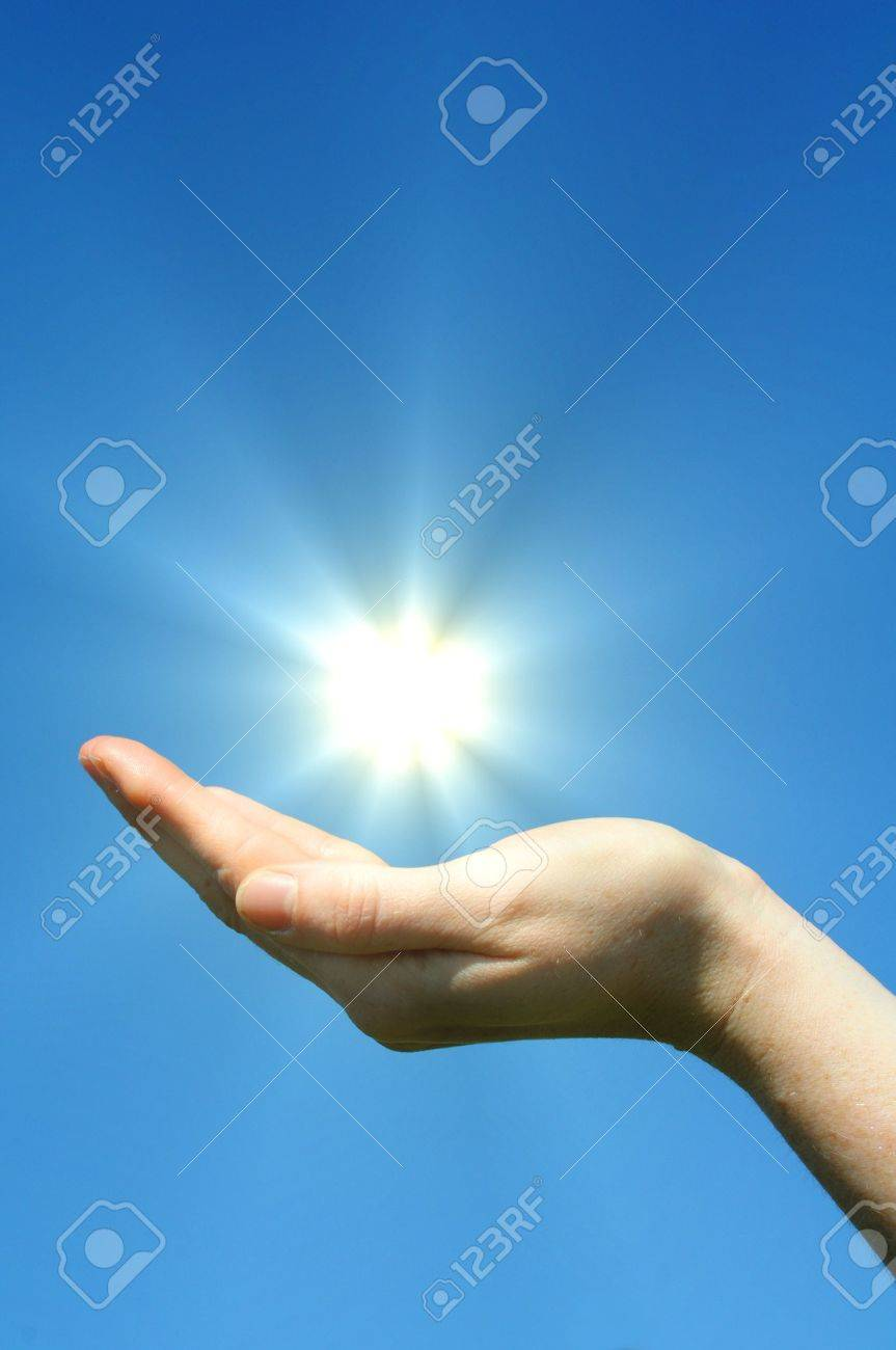 hand sun and blue sky with copyspace showing freedom or solar power concept Stock Photo - 7127363