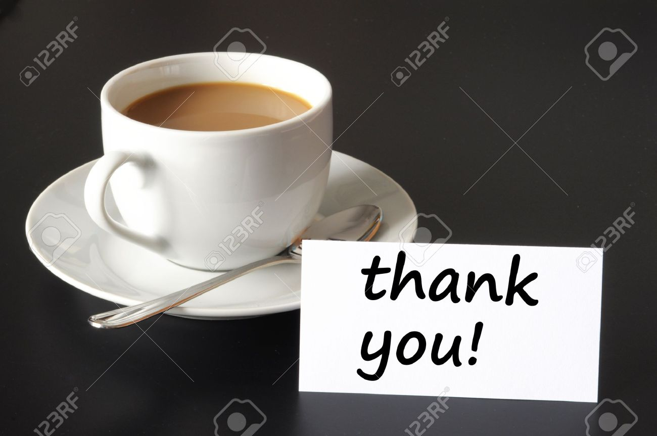 thank you or thanks concept with cup of coffee on black background Stock Photo - 7197289