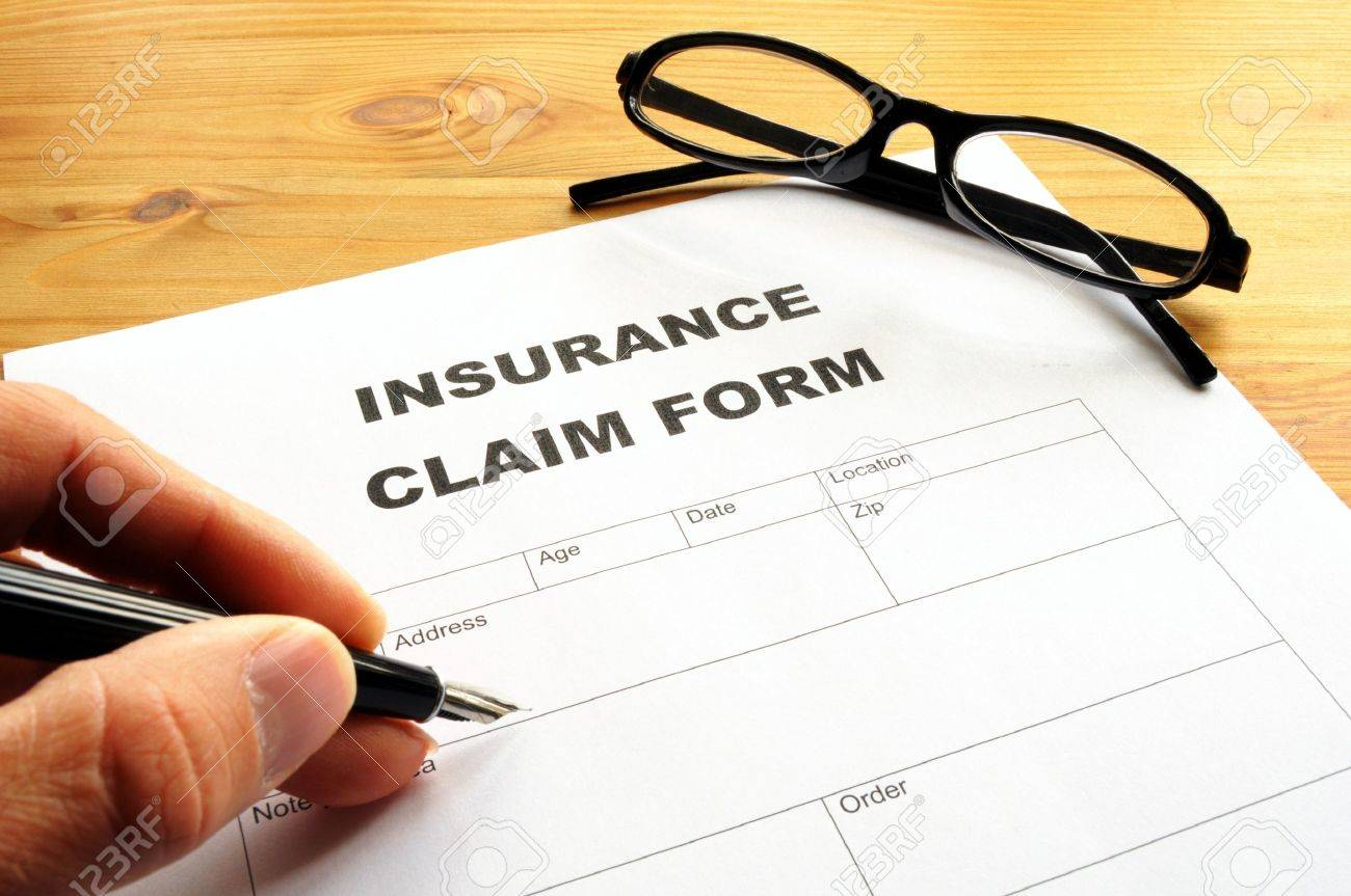 insurance claim for on desk in office showing risk concept Stock Photo - 7522313