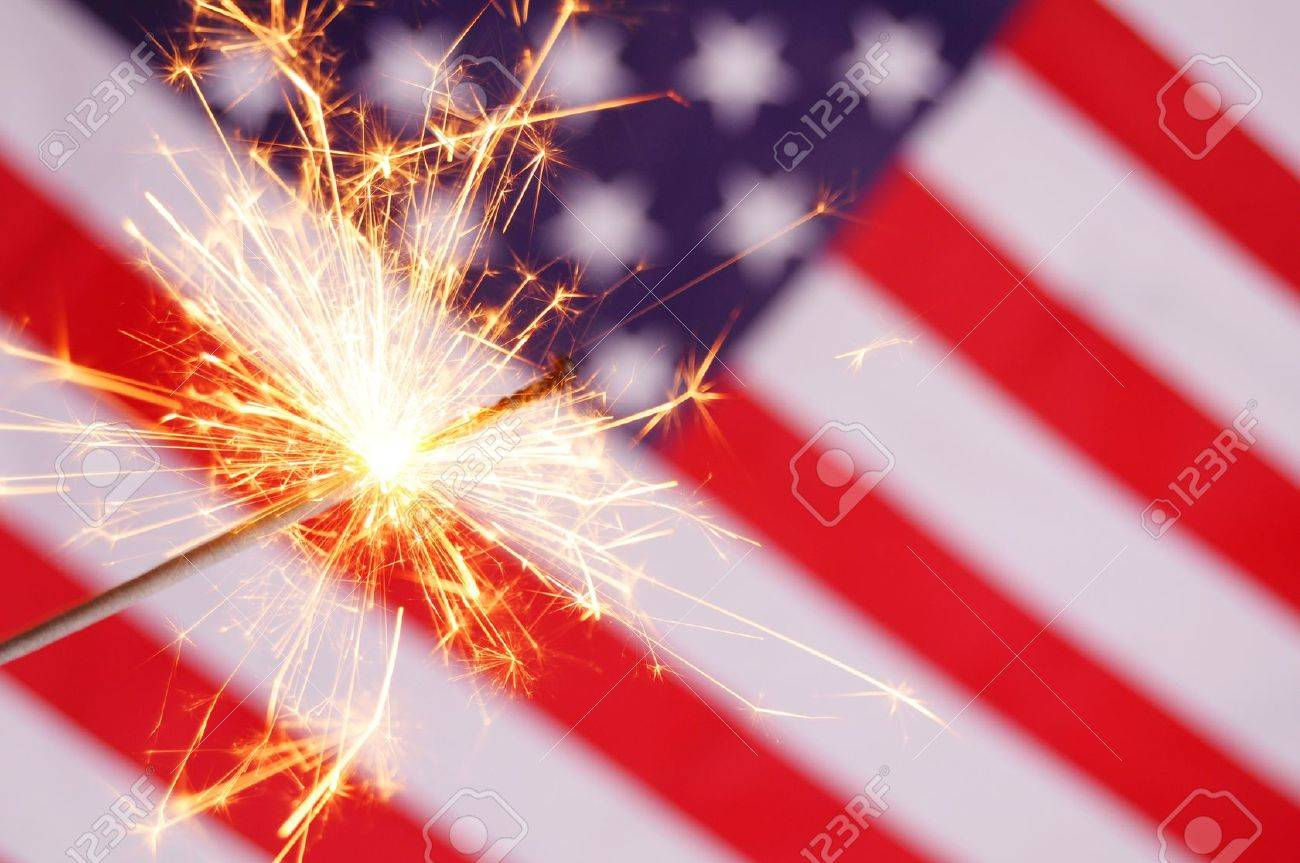 sparkler and usa flag showing 4th of july stock photo picture and