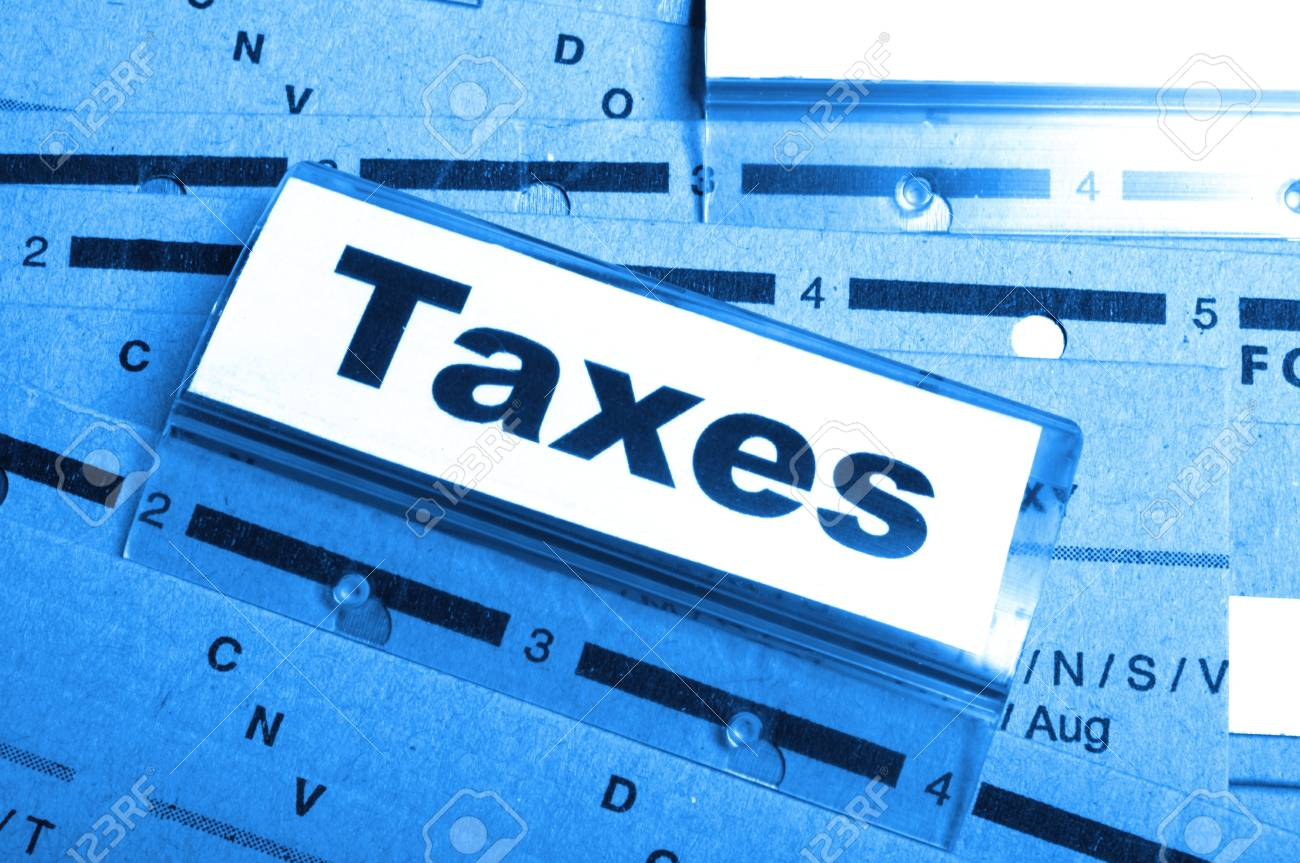 tax or taxes concept with word on business folder index Stock Photo - 9307511