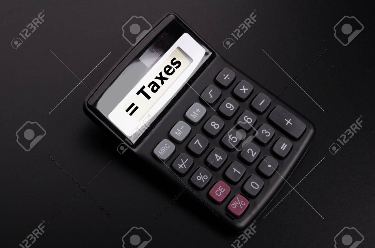 tax or taxes concept with business calculator and word Stock Photo - 9594648