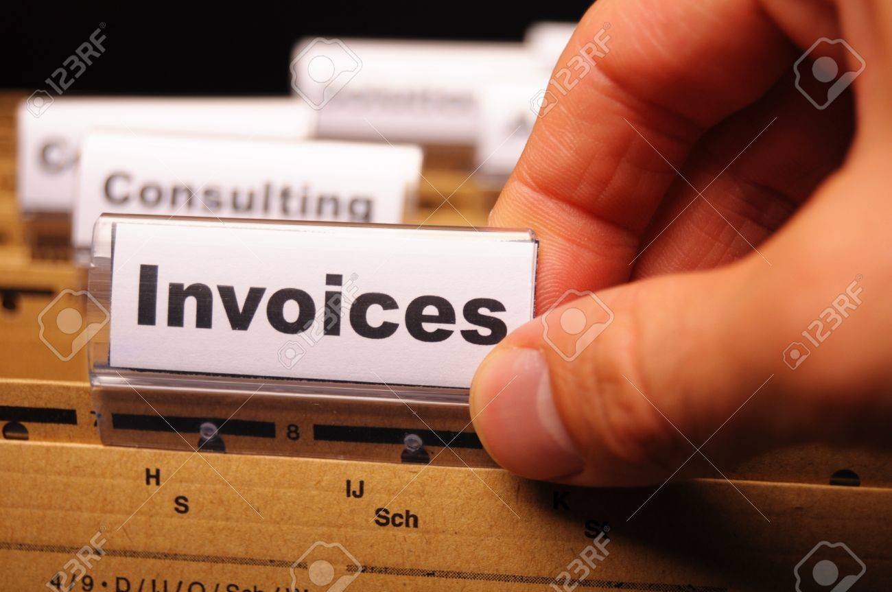 invoice or invoices concept with business folder in office showing paperwork Stock Photo - 9594649