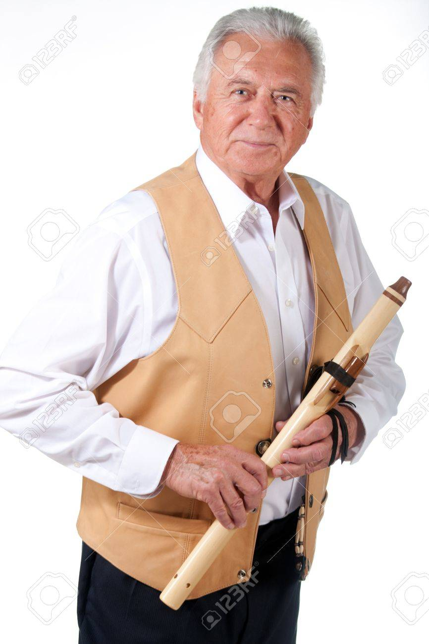 senior musician with native american flute and leather vest Stock Photo - 14410092