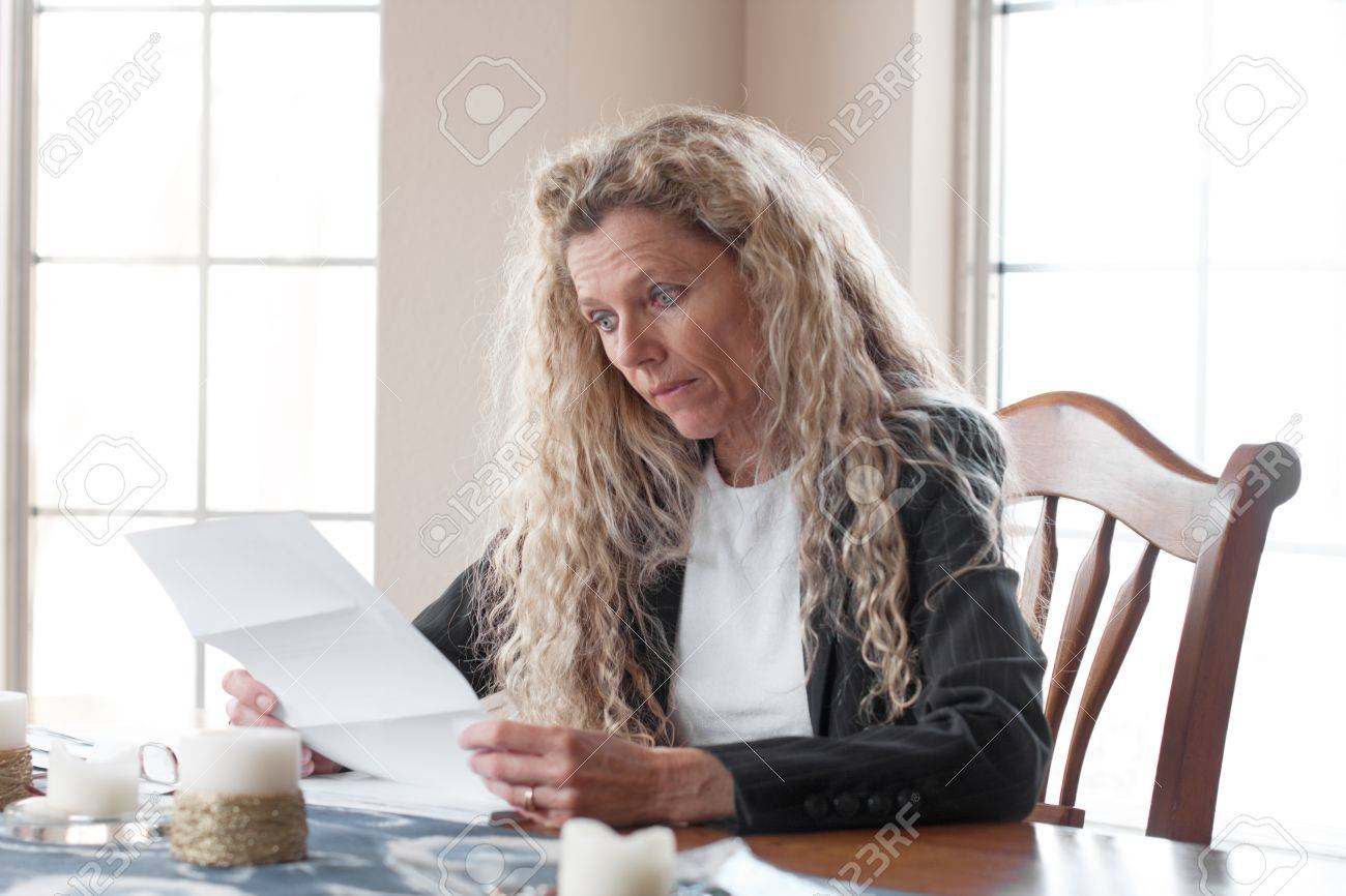 woman worried about bills and debt and foreclosure Stock Photo - 17796557