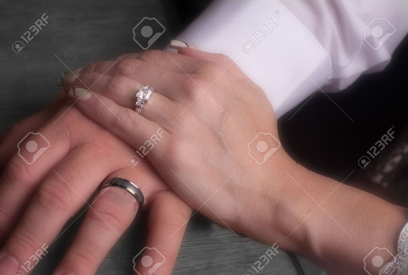 Male And Female Hand With Wedding Rings Stock Photo, Picture And ...