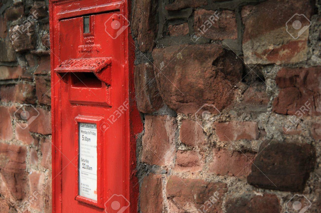 bright red postbox in old crumbling wall - closeup Stock Photo - 12008307