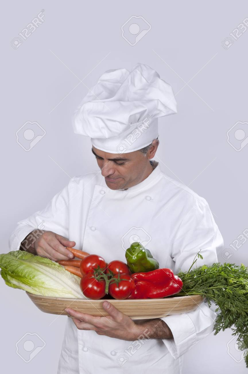 Chef with various vegetables in the hands - 38156050