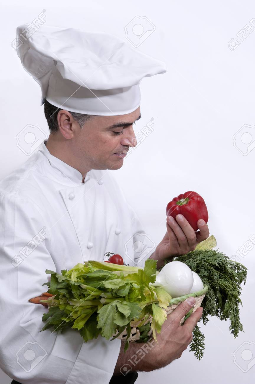Chef with several vegetables in the hands - 38156197